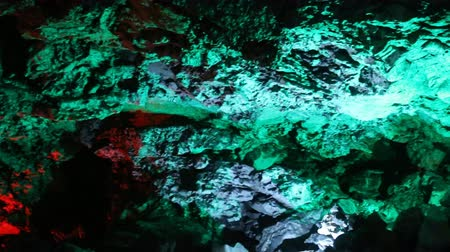 speleology : Karst cave in variety of colored light. Cave in carbonate rocks