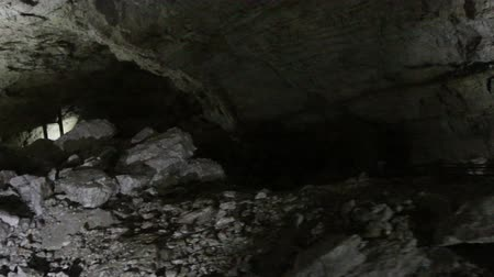landslide : Half-filled with rock and clay natural cave. After collapse of limestone cave, falling rocks.