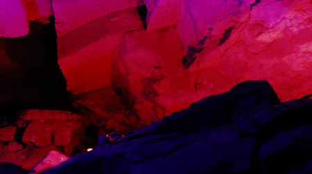 terra : Karst cave in variety of colored light. Cave in carbonate rocks