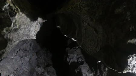 şaft : in karst cave. Sinters and drops on ceiling become, over time, stalactites and stalagmites