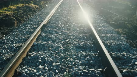 publicidade : Good frame for advertising of railway (advertising of freight). Setting sun and reflection on rails. photo contour