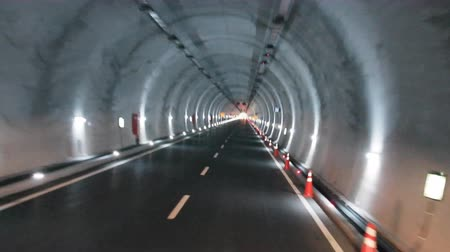 road tunnel : defocused road in tunnel driving background vehicle transportation