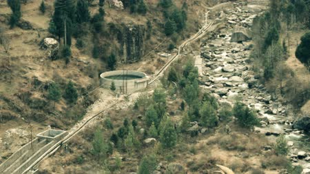 drinking water supply : Mountain river valley and water drainage system for irrigation, canal system, aqueduct, gutter, water intake, intake, winter low-water period. Foothills Of Himalayas. India Stock Footage