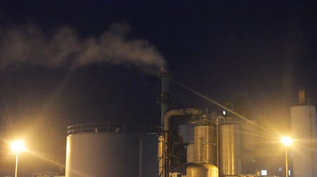 petroleum refinery : Plant for processing of oil illuminated with colored spotlights. Modern chemical production
