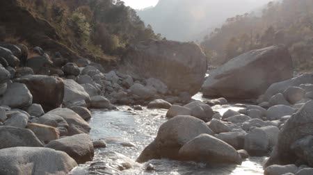 aqueous : Mountain river in winter low water period. Valley Of The Himalayas