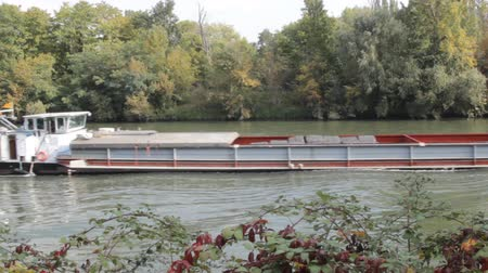 vnitrozemí : River navigation in France. Barge on Seine. cargo ships floating on river Dostupné videozáznamy