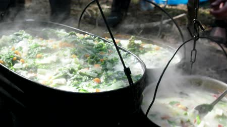 pokrzywa : soup on camping fire. food in pot in recreation