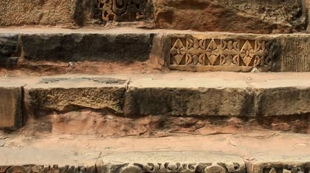 arabeska : Steps of the ancient Indian temple, steps with facing of carved stone. Symbol, entry character in the Indian ancient culture. camera rises