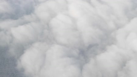 bulutluluk : Clouds in two layers from the plane window. Bottom layer as the fleece of a lamb and a cotton upper layer clouds