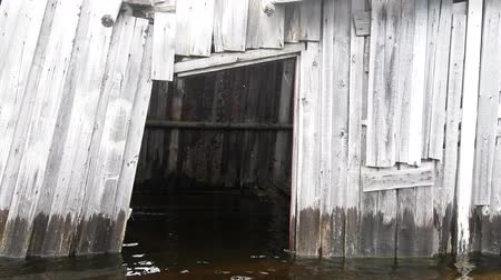 hammered : Board shed. Flooded the old boathouse hammered together from boards. North lake inundation, water logging Stock Footage