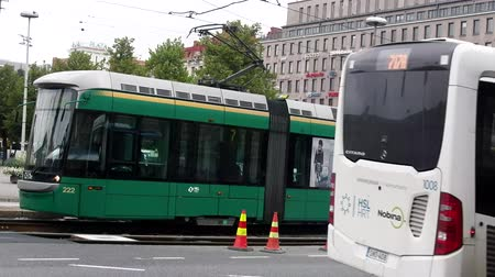 İskandinavya : Helsinki , Finland - August 20, 2017: City transport is a tram and bus with many carriages, like a train. Hybrid transport Stok Video