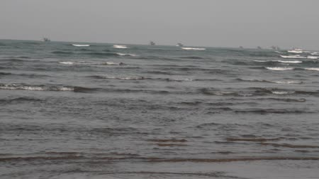 carrancudo : Malabar coast ,winter sea, Arabian sea ,inhospitable sea,, driving waves, fishing boats ,,horizon, Goa ,Kerala