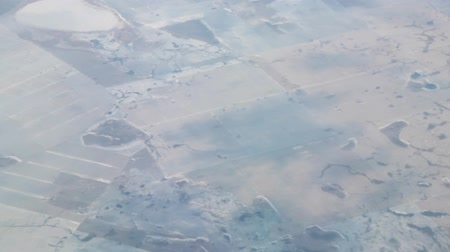 observation deck : Winter snow-covered fields of Kazakhstan, Flat foothills steppes partly under snow, view from aerial photography Stock Footage