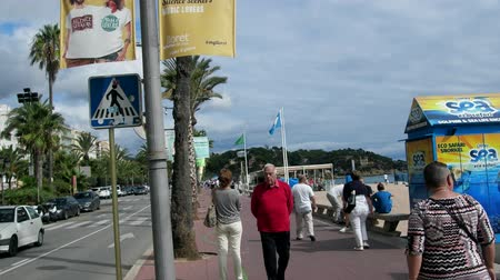 hordes : Spain, Lloret de Mar - October 2, 2017: boardwalk on beach, promenade, bridge, palm trees, hotels, tourists. Mediterranean resort
