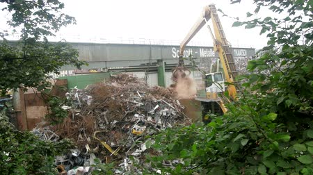 işlemek : Near Stuttgart, Germany - September 12, 2017: Enterprise for collection and recycling of scrap metal (scrap-metal drive, recycling), loading operations