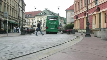patron : Warsaw, Poland - September 7, 2017: Tourist bus rides through the old town and city residents and tourists pedestrians