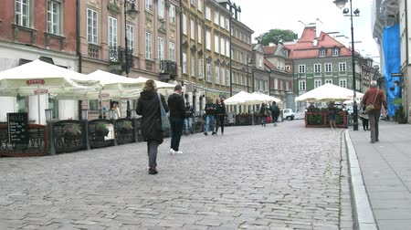 Warsaw, Poland - September 7, 2017: Tourists and locals on the streets of the old town where the cobblestone pavement and small restaurant, bistros and brasseries Wideo