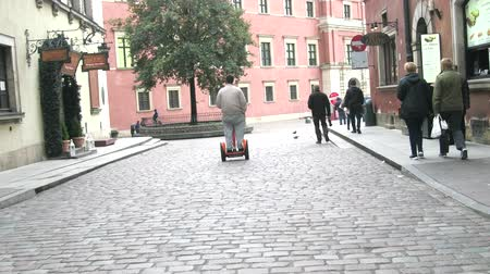 wrzesień : Warsaw, Poland - September 7, 2017: Walk on gyrocycle through the streets of the old town with a pavement which have become fashionable