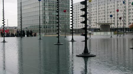 Paris, France - 24.09.2017: Defense, La Défense: water basin with lanterns of different shapes and color in the business district. Modern decoration of cities, urban design