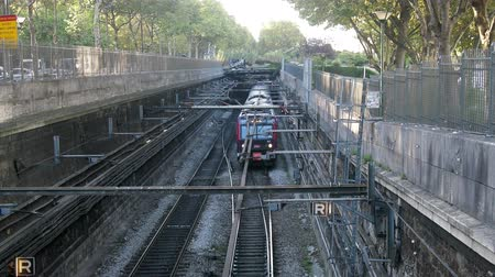 tramwaj : Paris, France - 24.09.2017: Paris metro line goes to day surface and is laid in special concrete trench with fence. time of passage of train, top view Wideo
