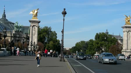pazar : Paris, France - 24.09.2017: Elysian fields (avenue des Champs-Élysées), Elysee palace. Golden winged horse statue on Alexander III bridge