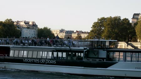Paris, France - 24.09.2017: River trams with tourists on the Seine