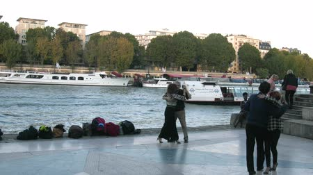 Paris, France - 24.09.2017: Parisians adulthood going on banks river Seine to dance, dancing evening - restored form of social life from antiquity, leisure of elderly Wideo