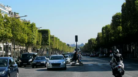 kikövezett : Paris, France - 24.09.2017: Champs Elysees is the main street of Paris, paved road and road transport