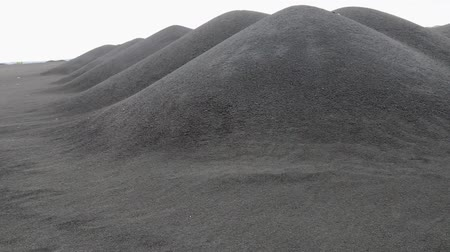 grit : The black cold desert winter. Dunes of black sand under the gloomy sky. Inhospitable environment Stock Footage