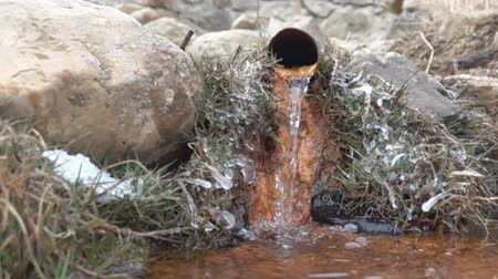 flange : pipe tap nasty rusty with running water. Primitive source of water in mountains. Super slow motion 1000 fps