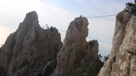 relics : Geological formation. Steep rocks in the old mountains, rock pillar, circumdenudation mountains, devils finger. Suspension bridge leads to one of the peaks