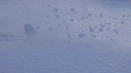 gazdasági pangás : Fresh snow blowout from falling. Snow explosion of snowy landscape. Concept of explosion of established provisions of business, stagnation, routine of life. Slow motion. Super slow motion 1000 fps Stock mozgókép