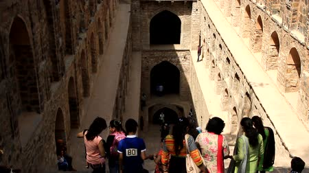 Students are going for photograph on steps of ancient Agrasen ki Baoli. - Water well with balack dead water, place of suicide