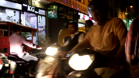 India, new Delhi - March 26, 2018: The city at night with the lighted shops, passersby and vehicles