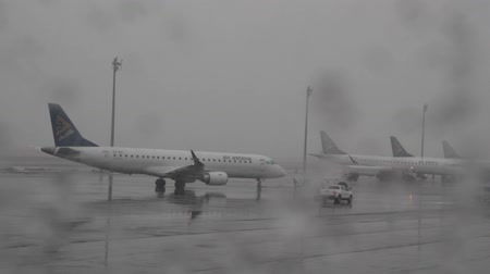 tüm : Kazakhstan, Astana - April 8, 2018: Winter heavy weather at airport of Kazakh capital Astana: there is wet snow, dense clouds. Airliner departs from landing zone to take-off floor.