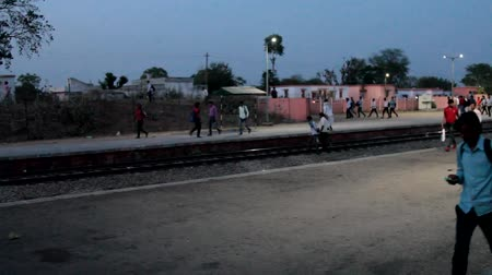 mozdony : India, new Delhi - March 26, 2018: Provincial Indian railway station. Passengers got off the train and cross the road without observing the transition