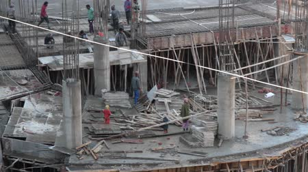 India, Himachal Pradesh- March 17, 2018: construction of multi-level Parking workers in a small town in Himalayas
