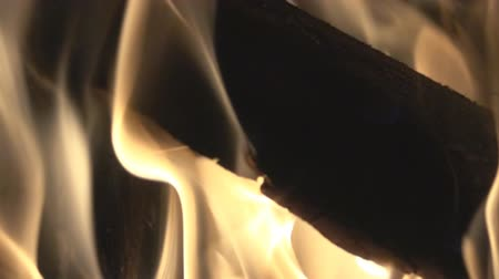ruddy : Burning wood, flames, coals. The magic of fire, fascinating spectacle since the time of ancient man. Super slow motion 1000 fps.