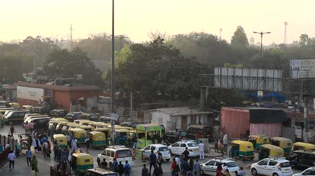 sight seeing : India, new Delhi - March 26, 2018: Station square with transport and passers-by. Yellow cabs, tuk-tuk. Top view