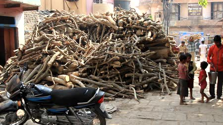 India, Varanasi - March 20, 2018: So - called burning wood. This wood is suitable for burning dead (body incineration) on sacred steps (Gathas) and are very expensive (depending on wood) Wideo