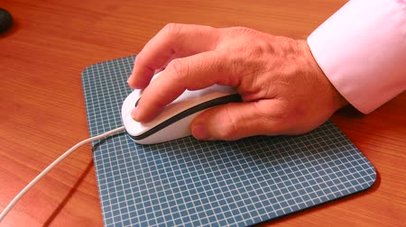 ergonomic : Closeup view of using a computer mouse, working in the office. 4K.