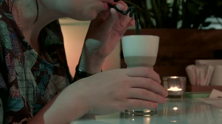 buzlu : HD A woman is sipping coffee from a glass cup. Stok Video