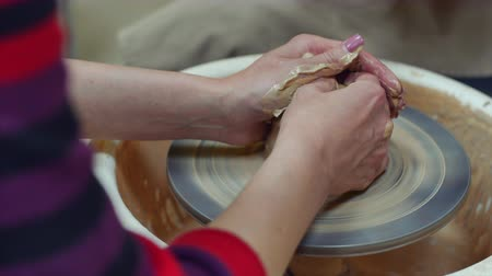 shaping : 4k Formation of the pot base on the potters wheel Stock Footage