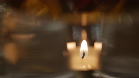 gyertyák : Close up shot of the candle flame. The image is blurred