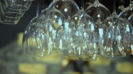 behind bars : Close up of empty glasses hanged up in a bar Stock Footage
