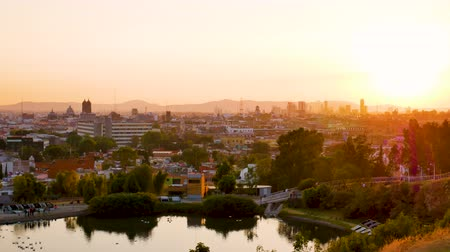 mexico city : View of Puebla de Zaragoza cityscape with orange sky at sunset