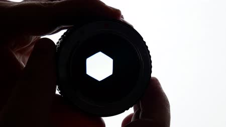 asal : Change of aperture a six-blade prime vintage lens on isolated white background. Stok Video