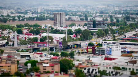 miniatűr : High view time lapse of traffic in Cholula city with bridge of Recta a Cholula, Tilt Shift Miniature Looks.
