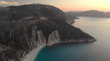 греческий : Aerial view of Myrtos beach at sunset, the most beautiful beach of Kefalonia Стоковые видеозаписи