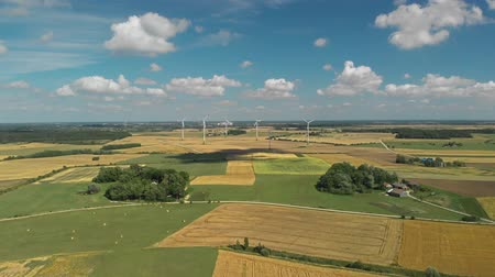 Aerial view of spinning wind turbines